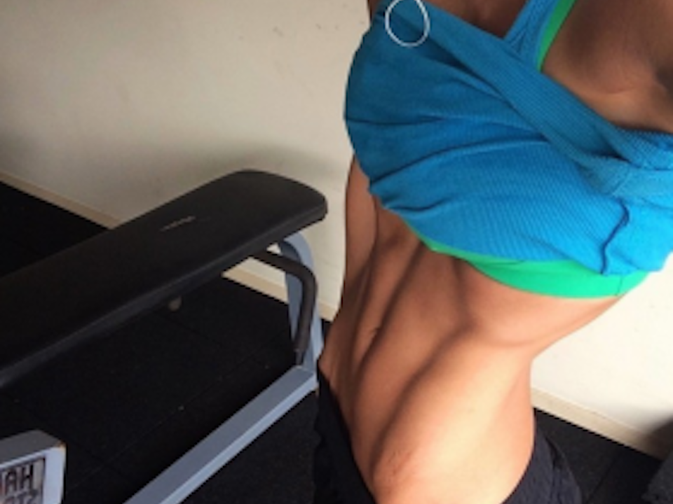 Sophie Guidolin abs and stretch marks wearing bright blue activewear