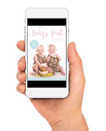 Baby's First Recipe Book Product Image of hand holding eBook with Evie and Aria