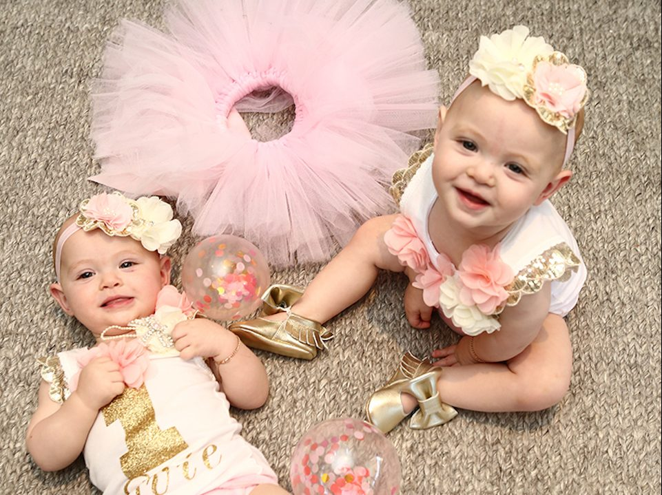 Twin girls with pink tutus on their birthday