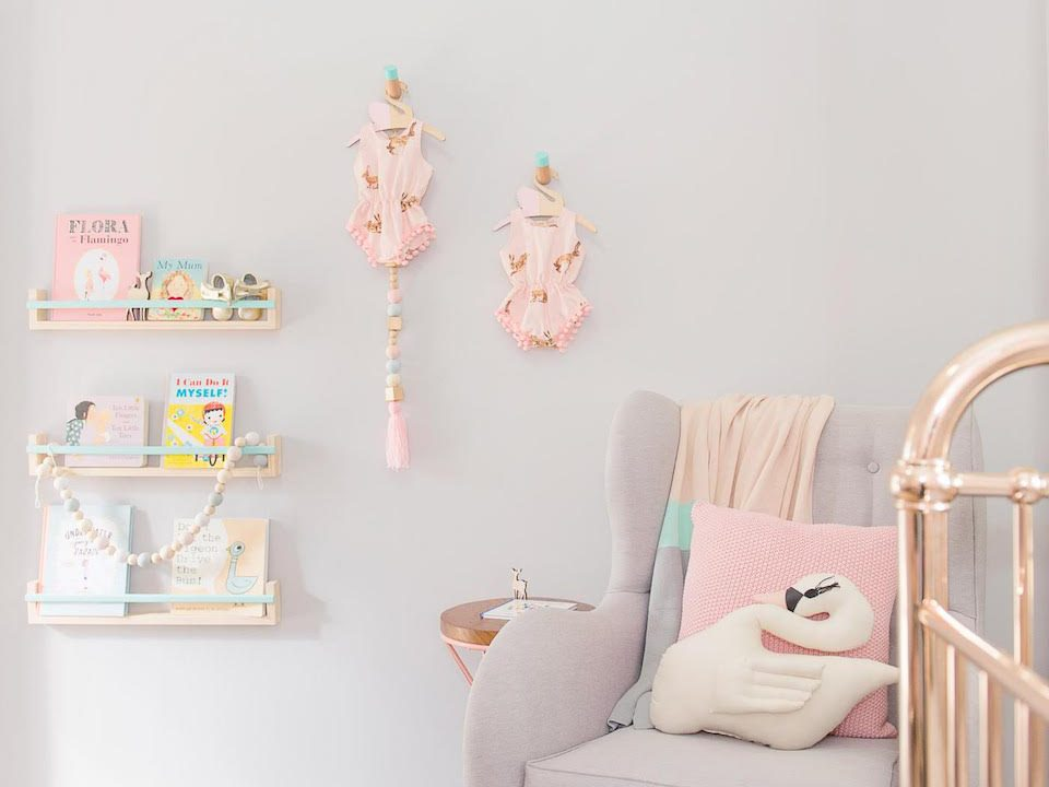 Nursery photo with pink furniture and rose gold cot