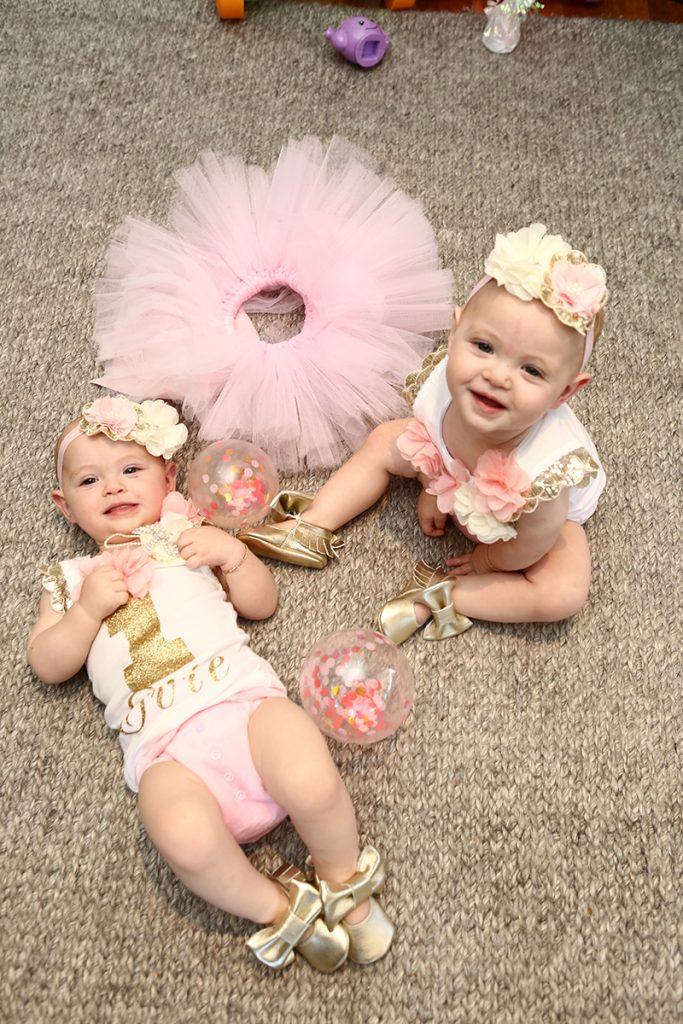 Twin baby girls with headbands and cute pink tutus