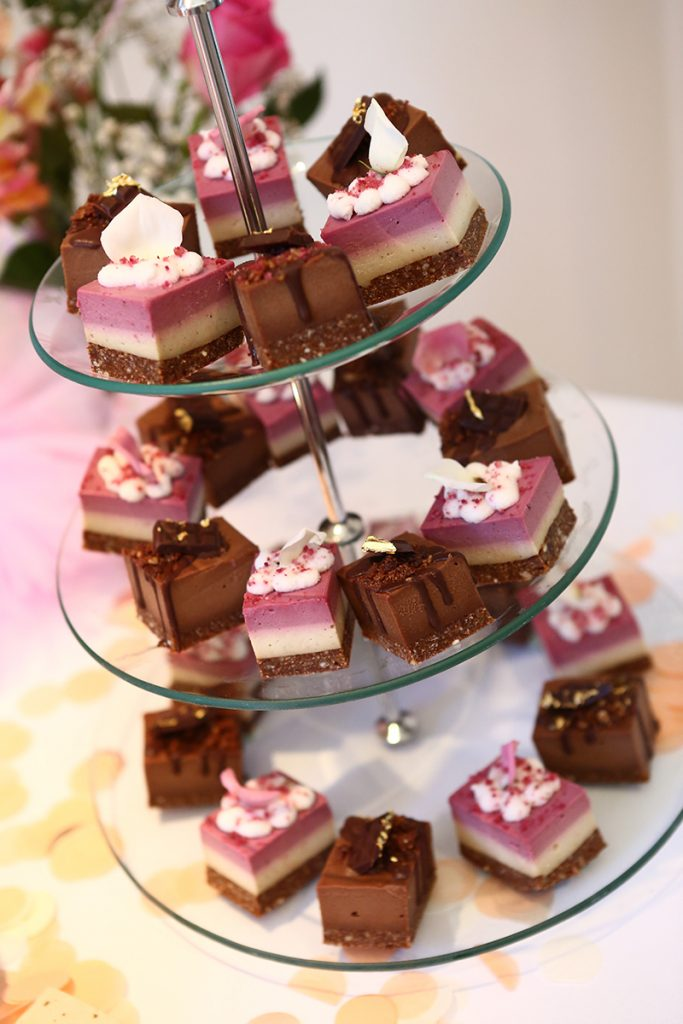 Raw vegan treats at little girls birthday party with pink and chocolate