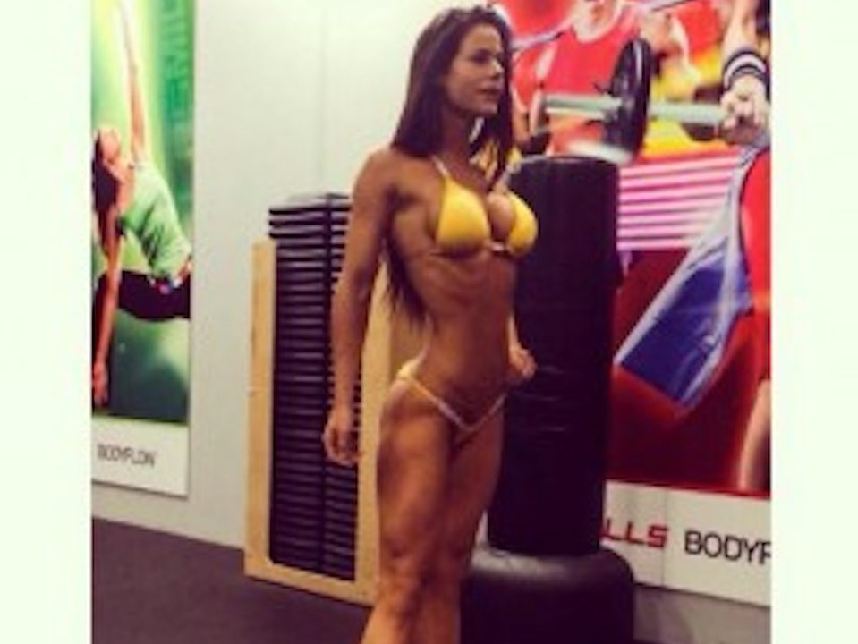 Sophie Guidolin posing in yellow bikini ready for fitness comp