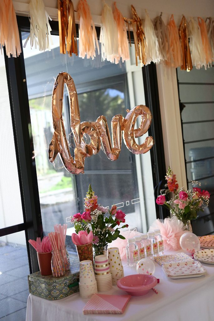 Rose gold balloon and cute table setting for baby's birthday