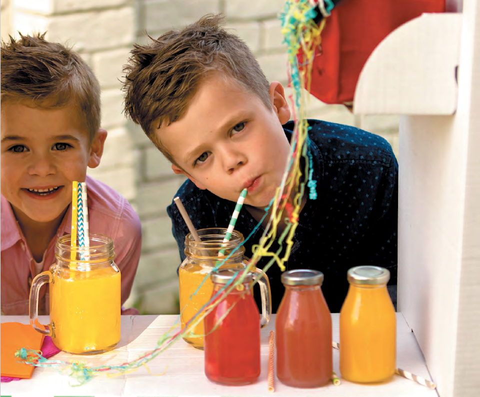 Boys with smoothies and juices at a picnic