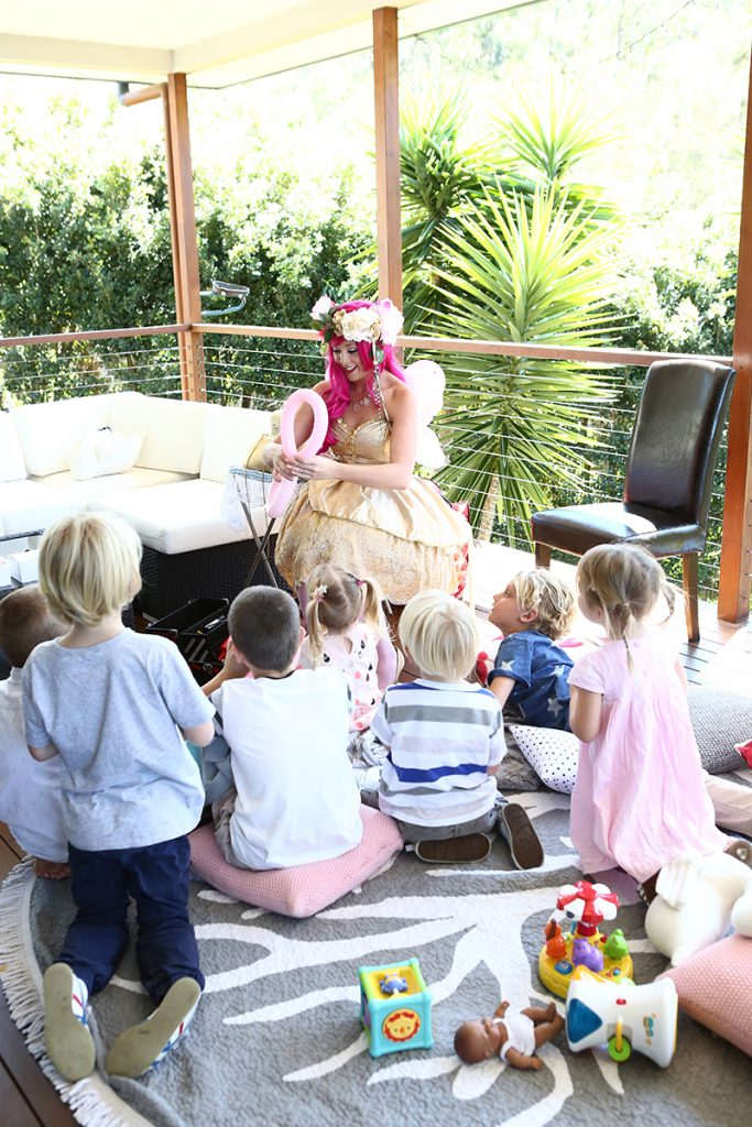 Childrens party with fairy sitting on the ground
