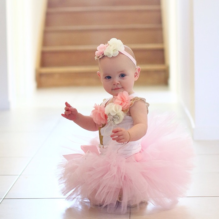 Adorable baby girl in pink ballerina tutu