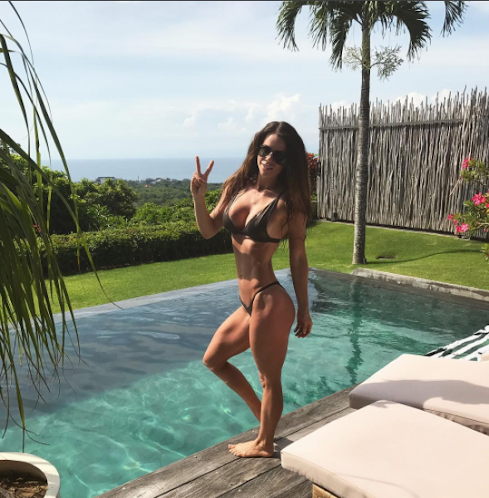 Sophie Guidolin standing by the pool in Bali