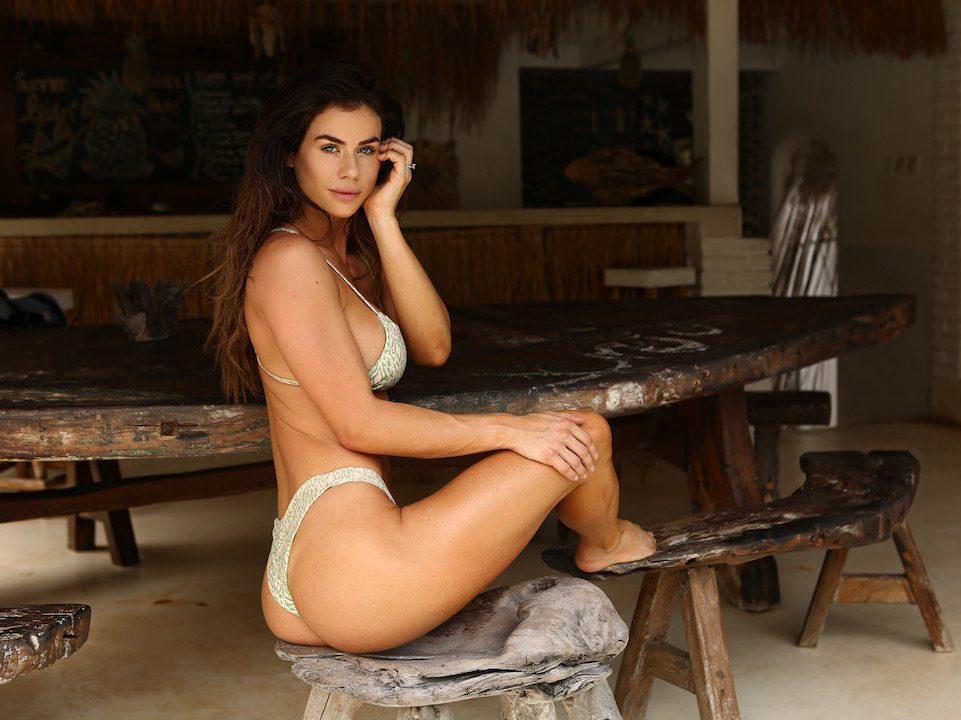 Sophie Guidolin in a bikini sitting on a chair in Bali