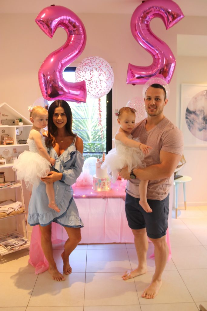 Twins birthday with pink balloon and unicorn cake