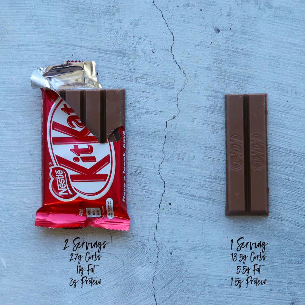 Whole kit kat and half eaten kit kat on marble background