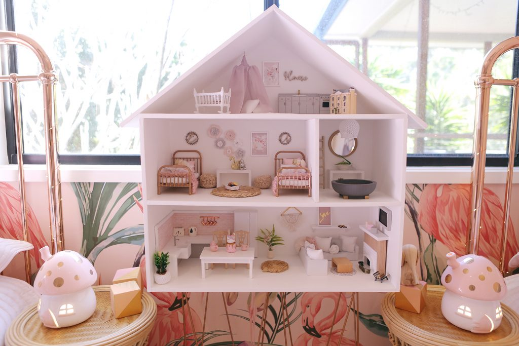 Dollhouse with vine name plaques in pink bedroom