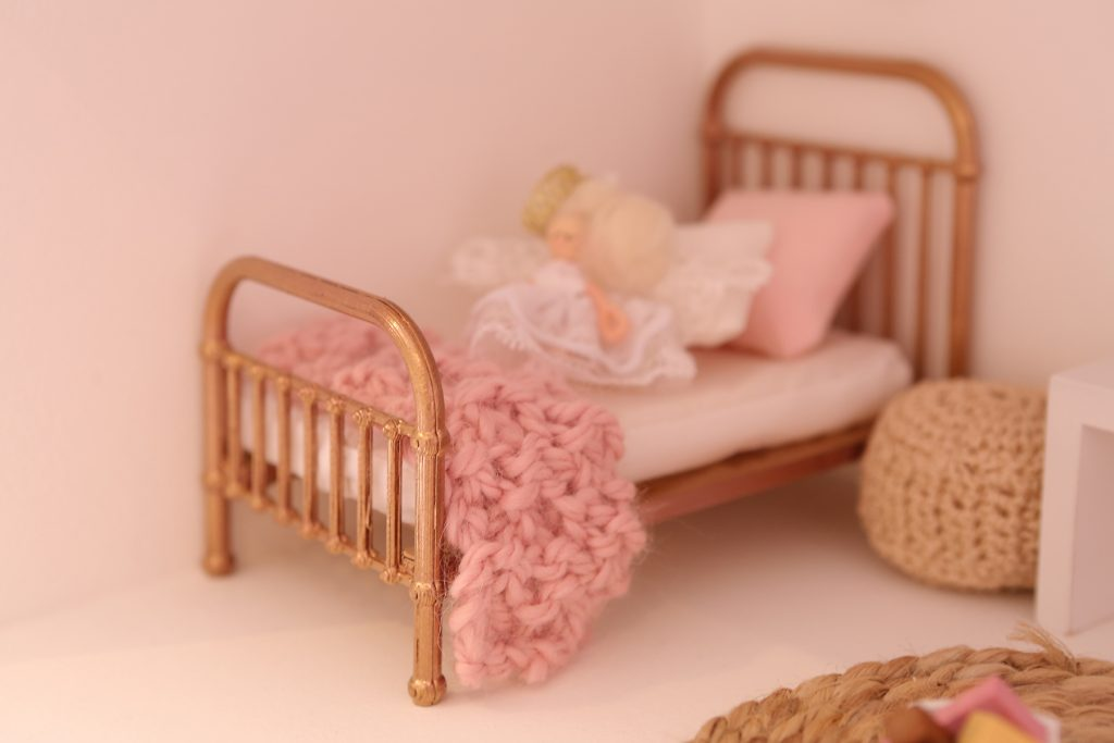 Tiny perfect world replica baby bed in dollhouse