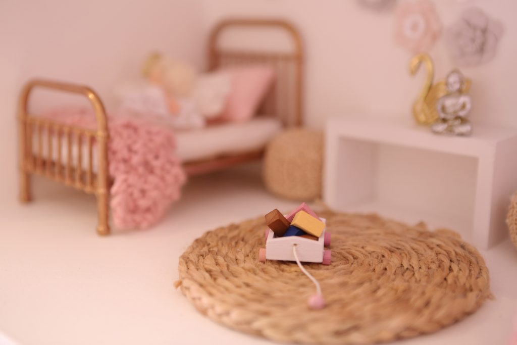 Dollhouse furniture, little bed and carpet