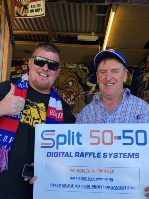 Ryan Rafferty, winner of the Bulldogs V Rooster Split 50-50 Raffle $603.50, with Split 50-50 Director, Andrew Cousins at My Money House.