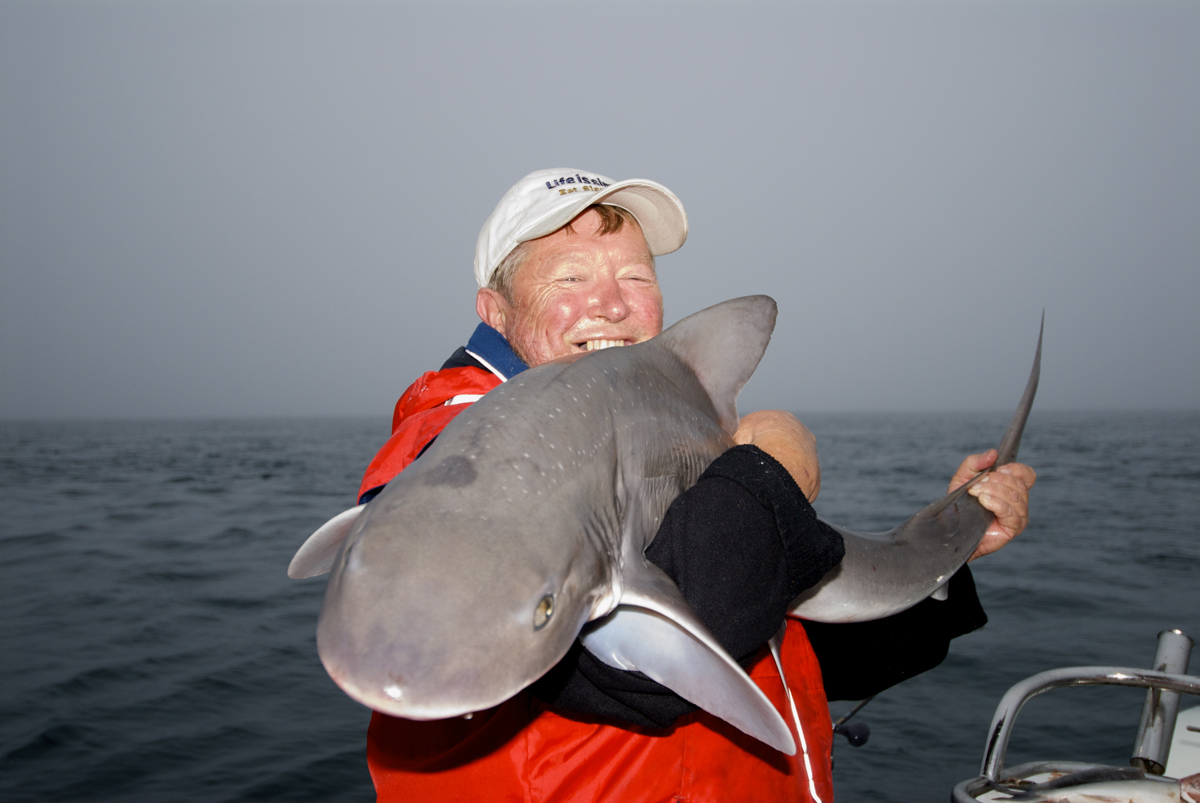 Steve Cooper shows off a 15kg gummy shark he caught in Western Port.