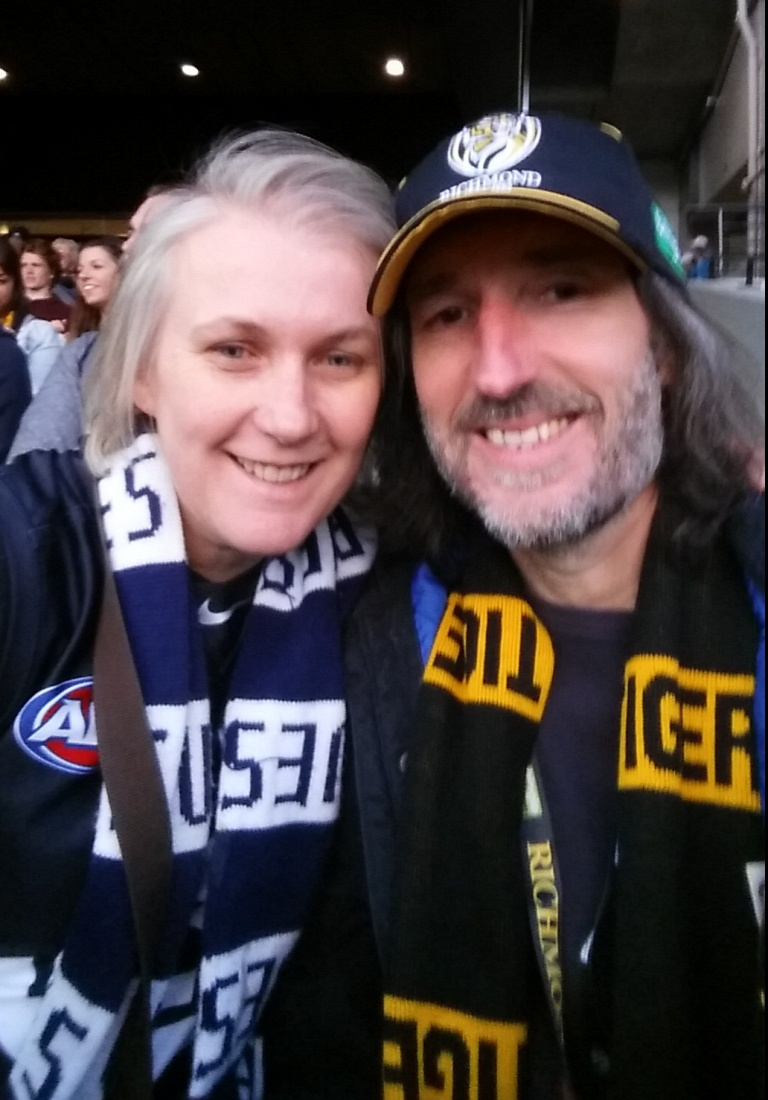 A couple of footy lovers. Greg Thom's turned Tiger but wife Jane sticks with her Blues.