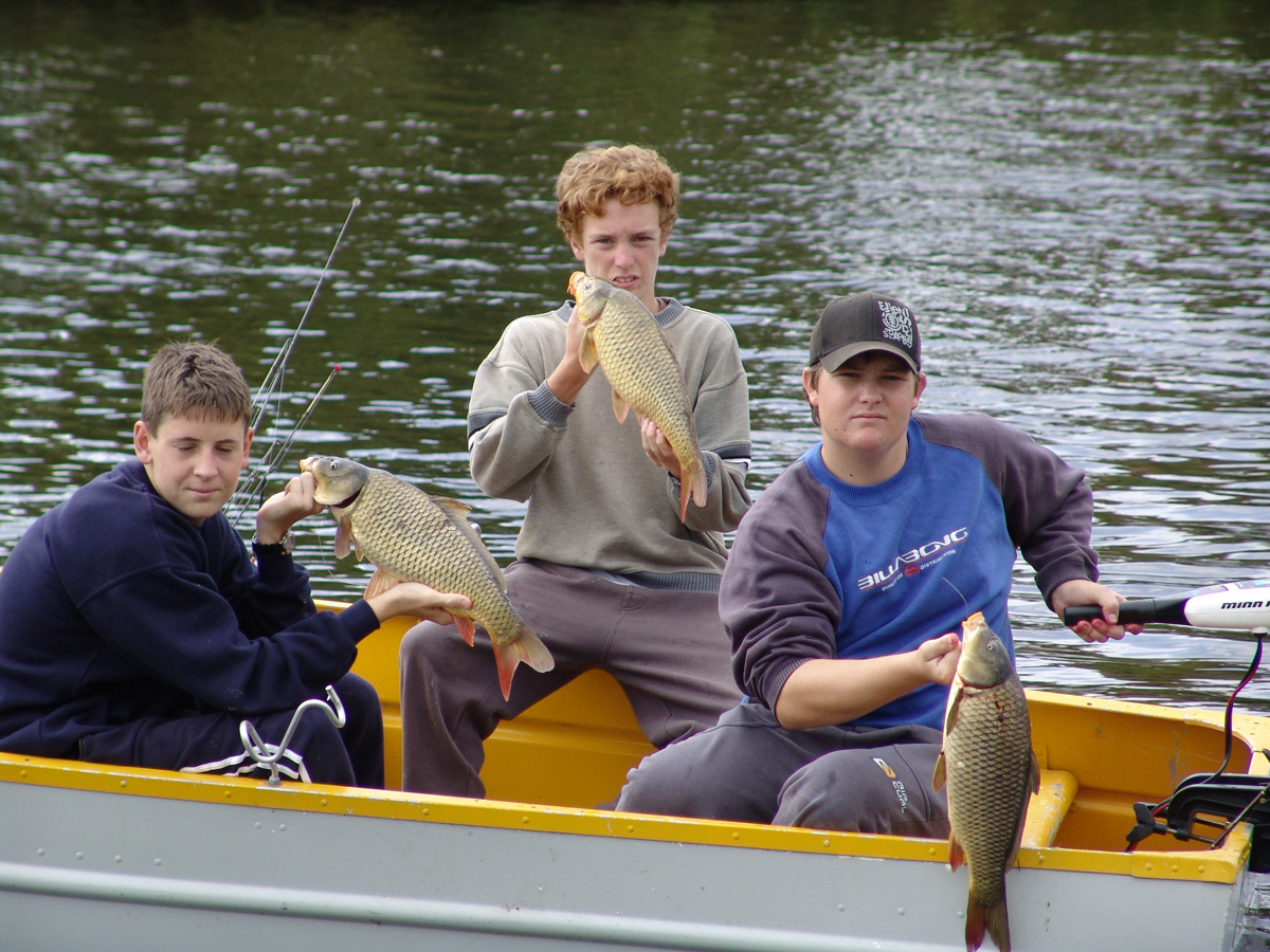 Young anglers enjoy hooking carp.