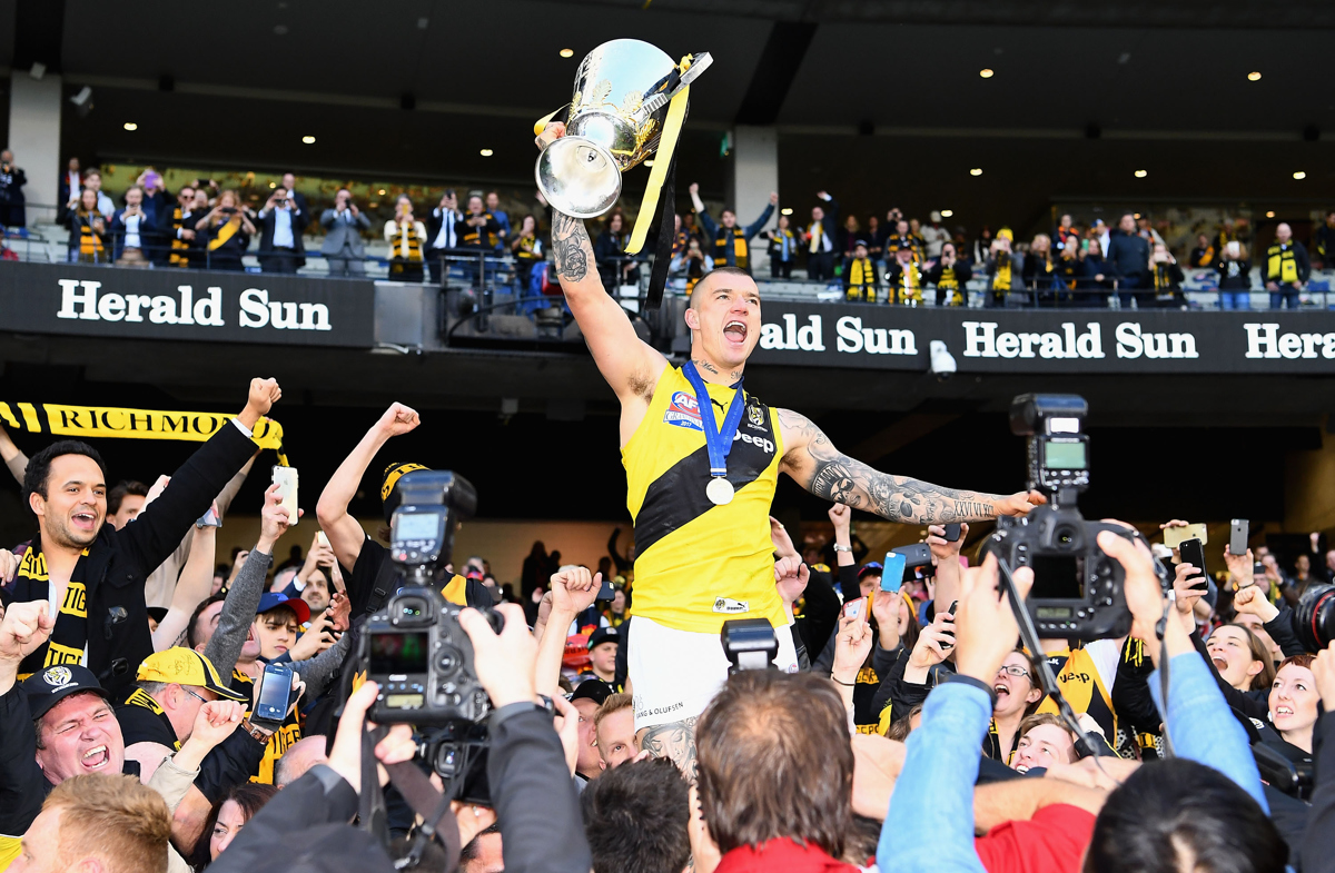 Dustin Martin celebrates with the Premiership Trophy