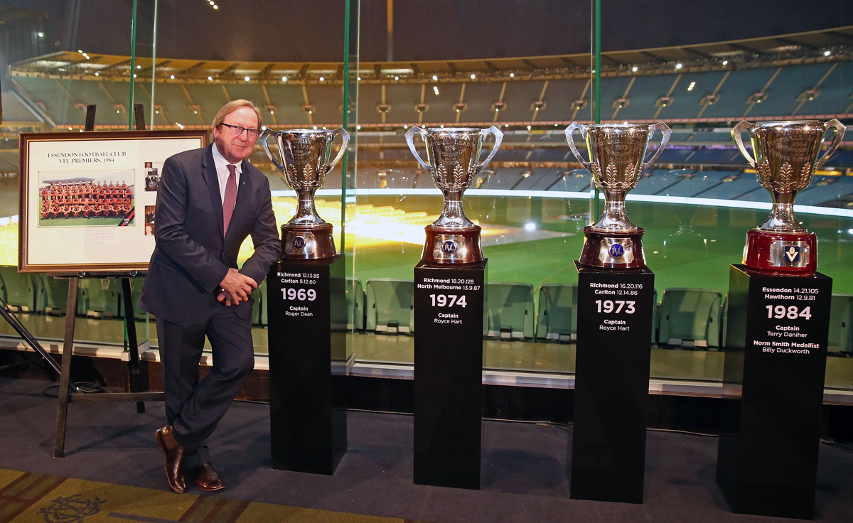 Kevin Sheedy stands next to AFL Premiership Cups he won after being a part of seven premiership teams during the '50 Years of Sheeds' Dinner. Pic: Scott Barbour/AFL Media/Getty Images