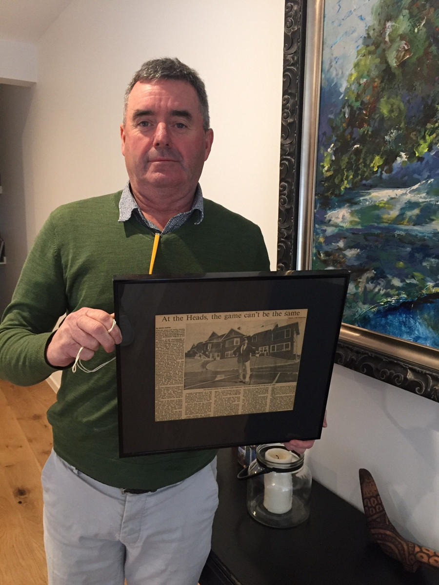 Shane McCarthy with framed article on Bud
