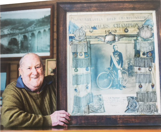 Alan Munro with a photo of his father Iddo, Australia's first Tour de France cyclist
