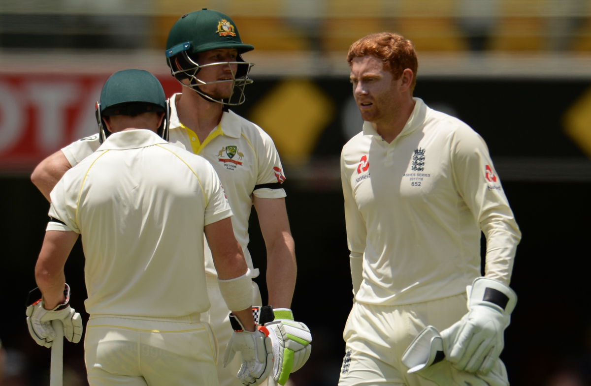 Jonny Bairstow walks past Cameron Bancroft and David Warner Pic: Philip Brown/Getty Images
