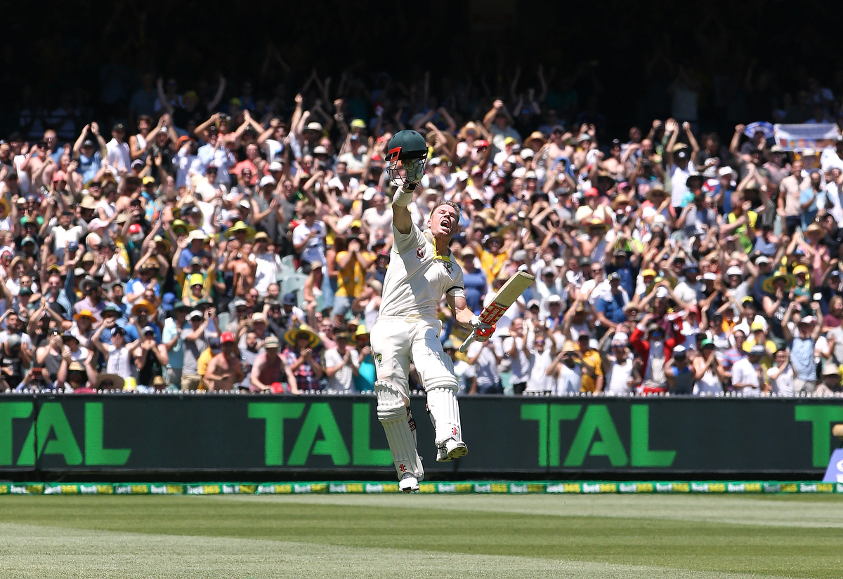 David Warner celebrates reaching his century at the MCG.
