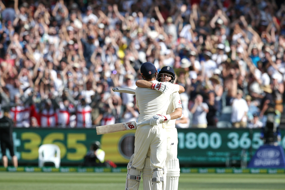 Alastair Cook hugs joe root after scoring his century.