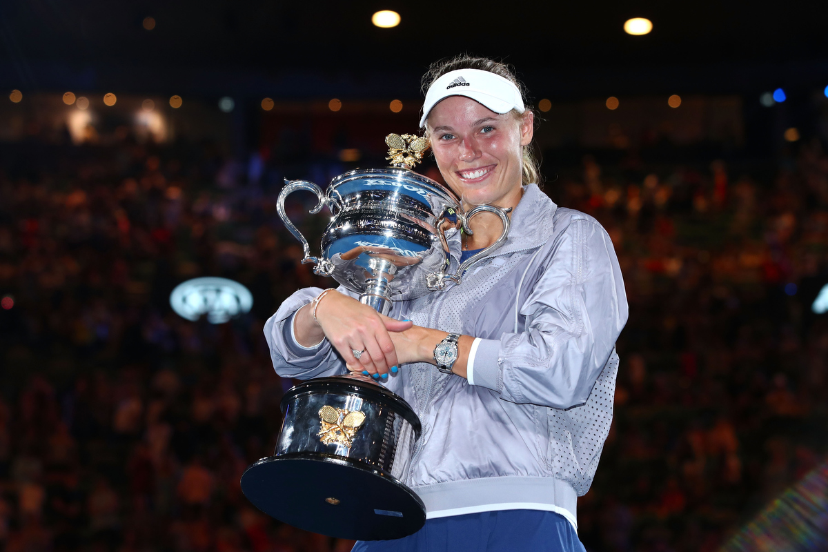 Caroline Wozniacki with the Daphne Akhurst Memorial Cup after winning the women's singles final against Simona Halep Pic: Clive Brunskill/Getty Images