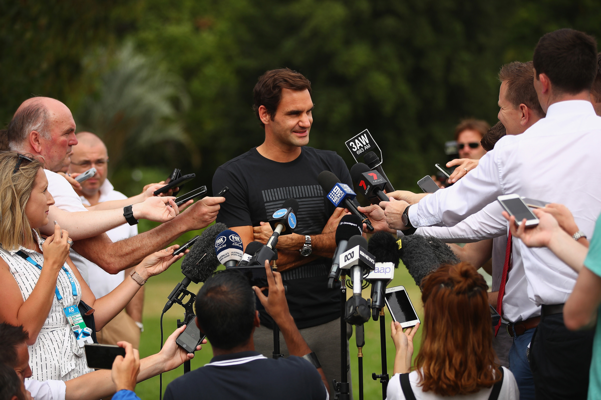 Roger Federer peaks to the media. Pic: Clive Brunskill/Getty Images