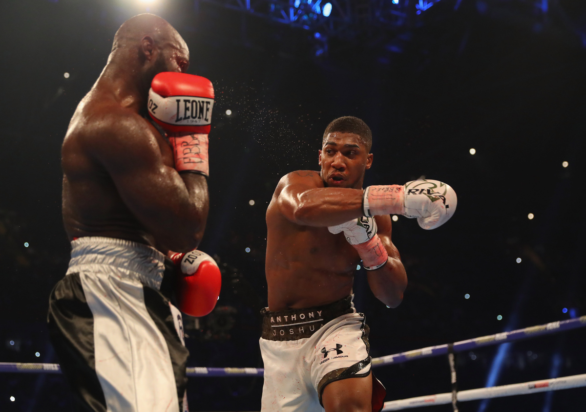 Anthony Joshua and Carlos Takam in action during their IBF, WBA IBO Heavyweight Championship. Pic: Richard Heathcote/Getty Images