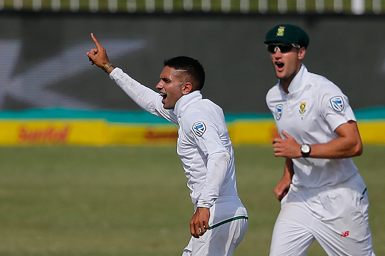 Keshav Maharaj (L) celebrates with teammates the dismissal of Shaun Marsh. Pic: MARCO LONGARI/AFP/Getty Images