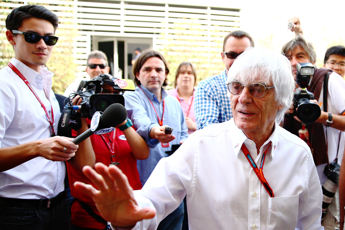 Bernie Ecclestone surrounded by photographers in the Paddock. Pic: Clive Mason/Getty Images