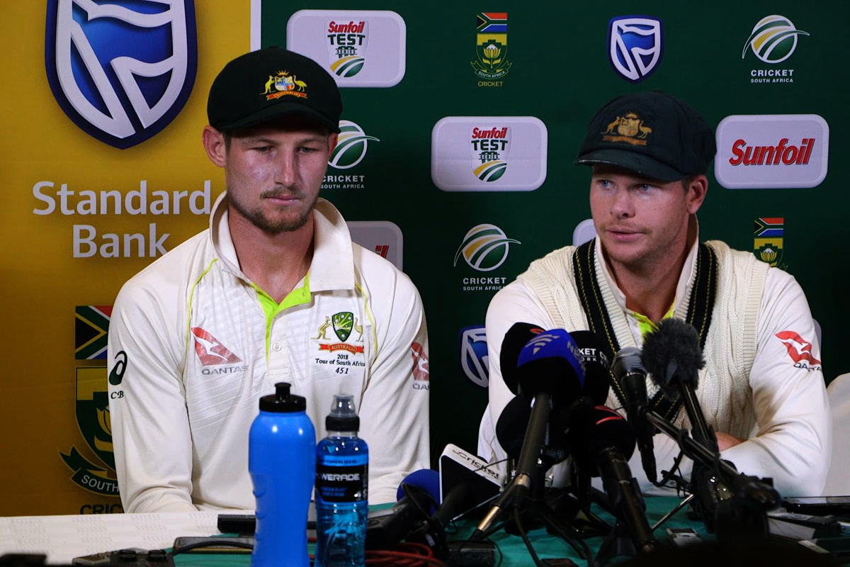Cameron Bancroft and Steve Smith during the press conference. Pic: STR/AFP/Getty Images