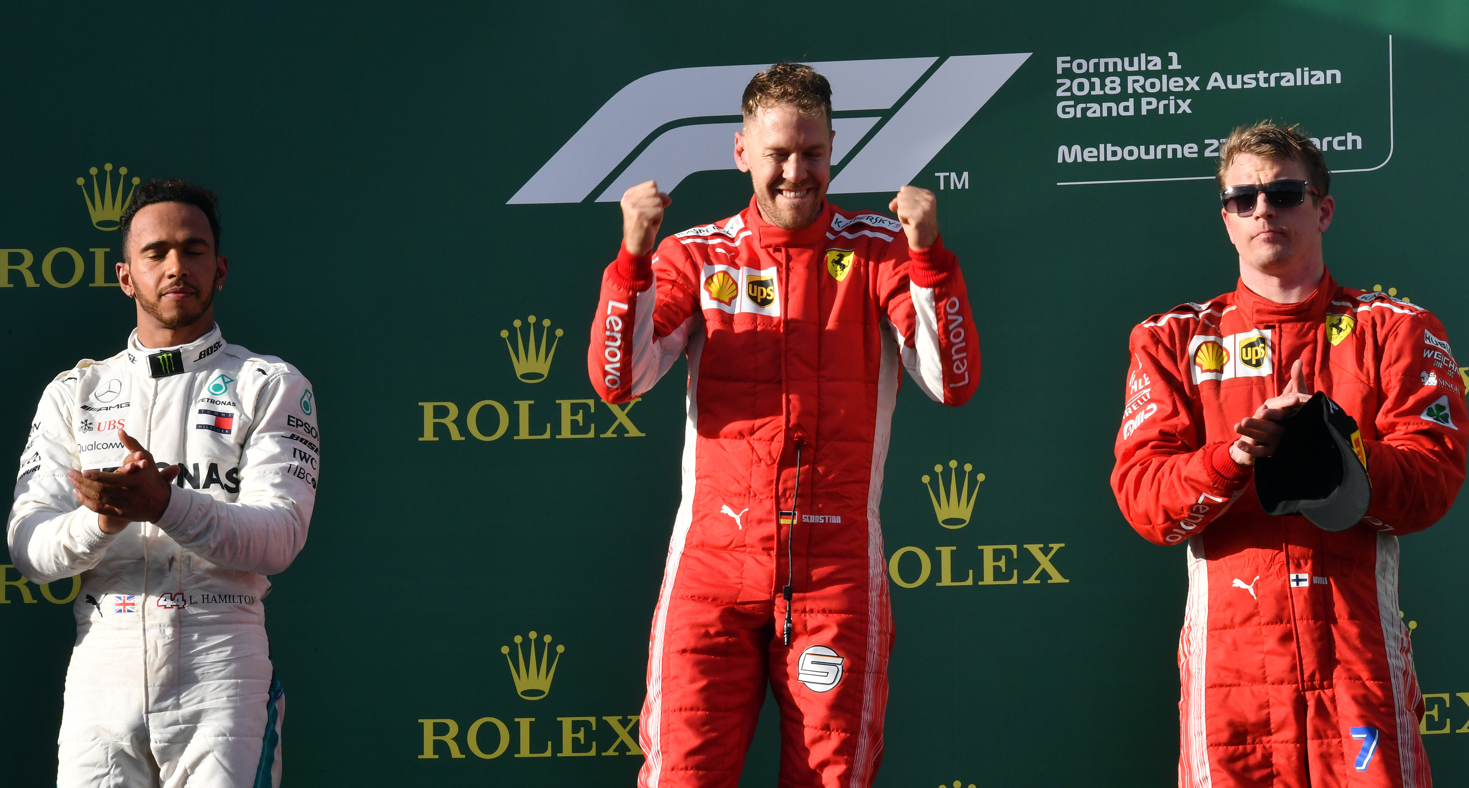 Sebastian Vettel (C) celebrates his victory on the podium next to second-placed Mercedes' British driver Lewis Hamilton (L) and third-placed Ferrari's Finnish driver Kimi Raikkonen (R) Pic:  SAEED KHAN/AFP/Getty Images