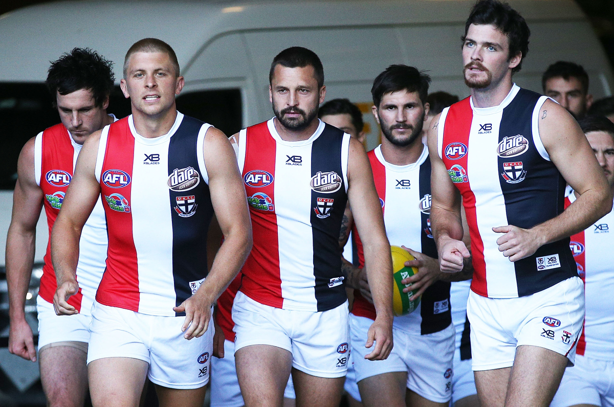 Jarryn Geary of the Saints leads the team out against North Melbourne on Good Friday. Pic: Michael Dodge/Getty Images