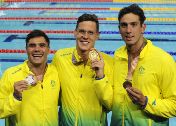 Commonwealth Games. Swimming Finals Night 4. Medal Ceremony for the Men's 50m Backstroke Final. Benjamin TREFFERS, Mitch LARKIN and Zac INCERTI