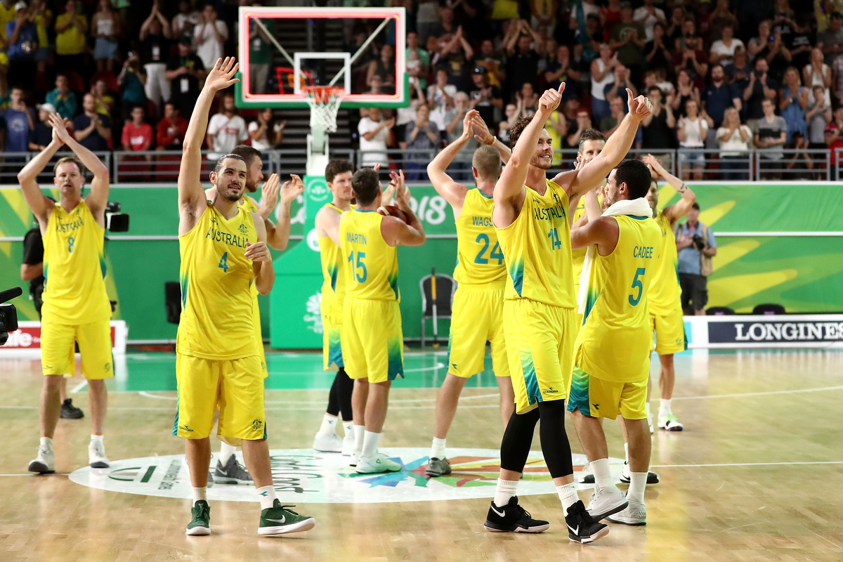 Australia celebrate winning gold in the Men's Basketball against Canada. Pic: Ryan Pierse/Getty Images