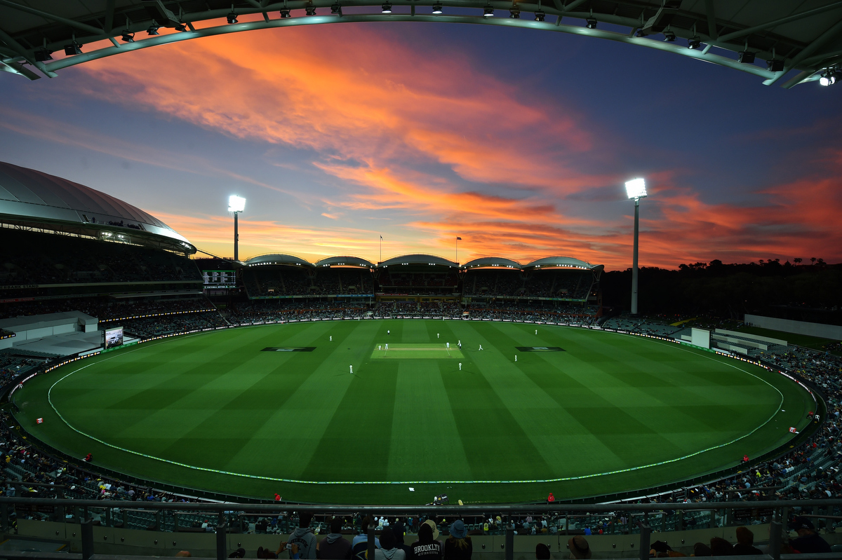 The sun sets during the first innings of the day-night third Test cricket match between Australia and South Africa at the Adelaide Oval. Pic: PETER PARKS/AFP/Getty Images