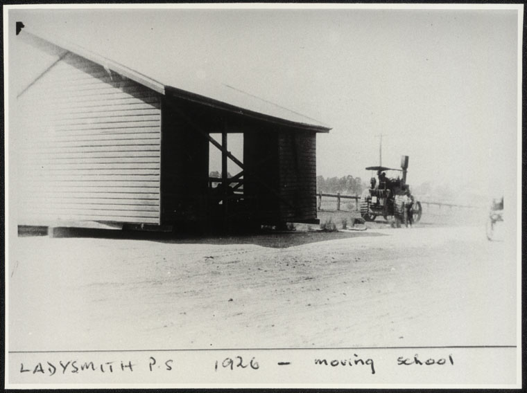 Ladysmith Public School - moving school [building being moved by tractor]