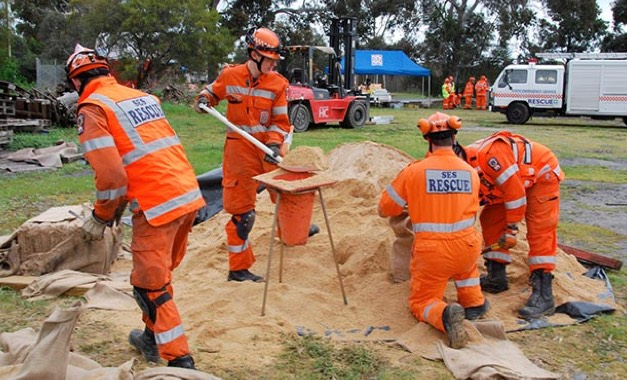 SES volunteers fill sandbags for upcoming storm and flood