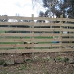 The new fence now in place, waiting for the wisteria to grow