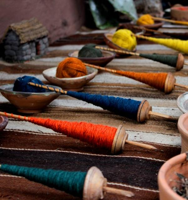 Coloured yarn at a market photo by julian mora on unsplash