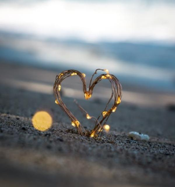 Heart on sand photo by steve halama on unsplash
