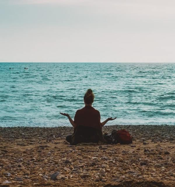 Woman on beach with hands in question pose photo by dardan on unsplash