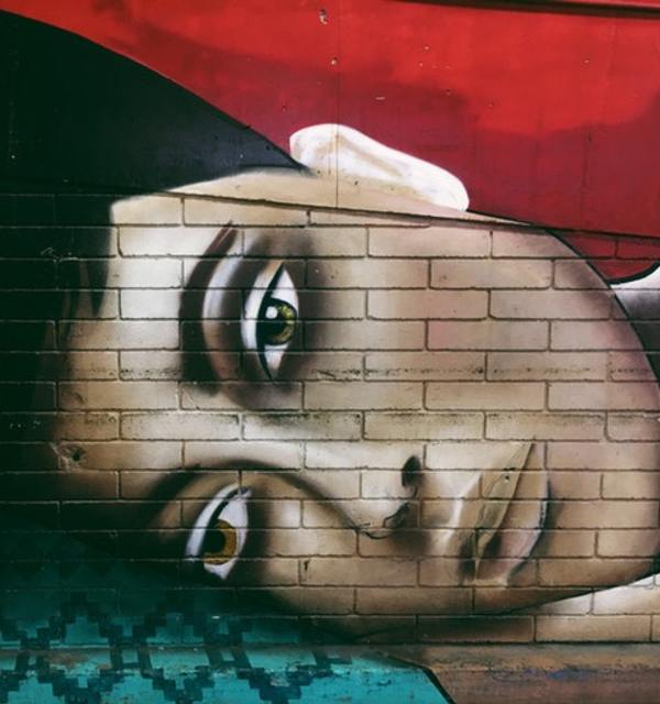 Mural woman face lying down photo by jon tyson on unsplash