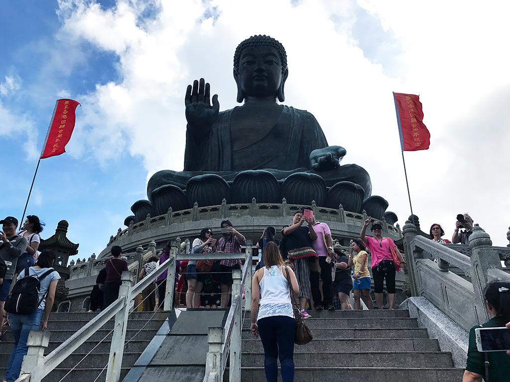 Climbing up to see a close up of Tian Tan Buddha