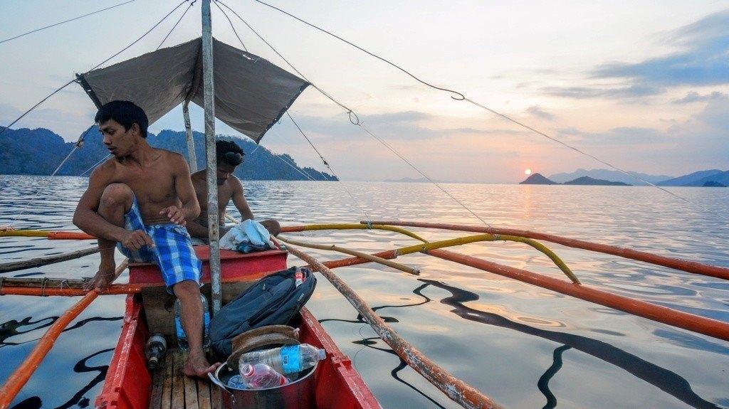 Boatmen and bancas in Coron