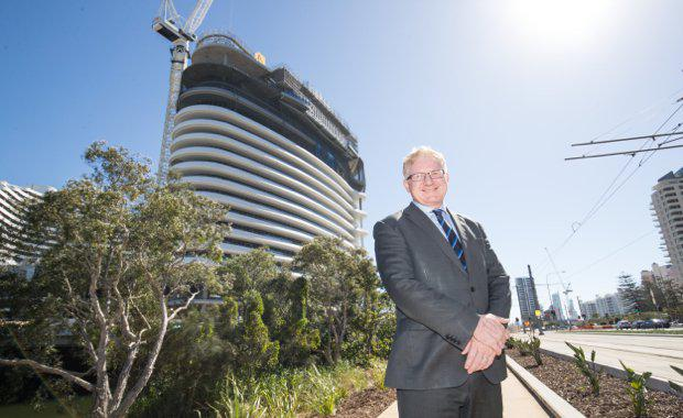 Geoff-Hogg-stands-in-front-of-The-Star-Gold-Coasts-six-star-tower-2_620x380